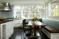 I like many different elements in this kitchen.  I like the apolstered bench, lots of windows, the beautiful stainless hood and the blue glass back splash.  Pretty, pretty, especially with the blue and white together.
