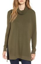 Free shipping and returns on Caslon® Knit Tunic (Regular & Petite) at Nordstrom.com. A relaxed silhouette defines a soft tunic fronted with slit pockets and finished with button-tab sleeves.