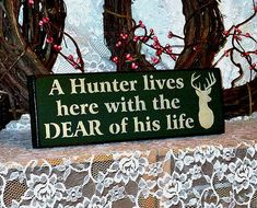 A Hunter lives here with the Dear of his by thecountrysignshop