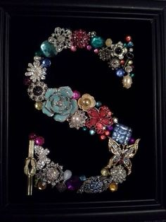 "Vintage and costume jewelry on black velvet in the shape of the letter ""S"" framed for display on Etsy, $65.00 by maria.t.rogers"
