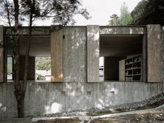 Hiroshi Sambuichi - Atelier and store, Hagi 2002. The wood for the concrete formwork was reused for the shutter doors and flooring, creating identical patterns in two materials.