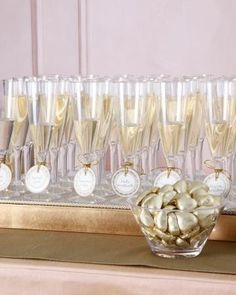 Seating cards with your glass of bubbly! Like the gold chocolate Dove hearts.
