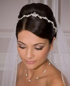 Tiaras can be simple and elegant, especially when paired with a sleek updo.