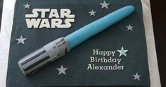 """Star Wars chocolate cake with buttercream icing. Rice Krispie light saber covered in fondant. 11 x 15"""" cake."""