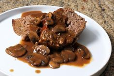This meat loaf is dressed up with an easy and nicely seasoned mushroom gravy. This tasty meat loaf includes a variety of seasonings, but it's a snap to prepare and bake.
