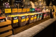 Lots of chocolate bars at the new indi chocolate Factory and Cafe in Pike Place MarketFront in Seattle, WA Chocolate Factory, Chocolate Bars, Spice Rub, Few Ingredients, How To Make Chocolate, Cocoa Butter, Lip Balm, Body Care, Yummy Treats
