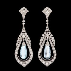 Platinum Art Deco Earrings feature 2 Briolette Aquamarines Enhanced with 110 Round Cut Diamonds for approximately 1.0 carat along with 24 Dark Blue Faceted Sapp