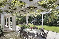 Beautiful patio cover featuring lush vines.  Perfect for enjoying brunch!  Landscaping Network Calimesa, CA