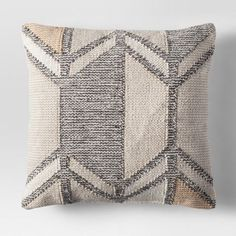 Toss this Gray Patterned Throw Pillow from Project 62™ anywhere — from beds to couches to entryway benches — to instantly bring soft, modern decor to your space. The neutral accent pillow is easy to pair with anything you already own, and its soft cotton material is comfortable to snuggle up with when you want to relax and unwind.<br><br>1962 was a big year. Modernist design hit its peak and moved into homes across the country. And in Minnesota, Target...