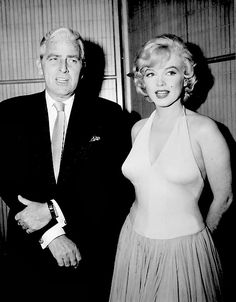 Buddy Adler and Marilyn at a press conference for Let's Make Love in January 1960.
