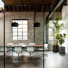 Conference room - white eames chairs, black lights, glass partition. (Warehouse turned into a loft office | Interior Square)