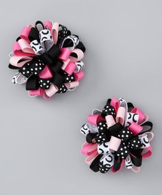 Adding a fun finishing touch to any outfit is easy with this cheery alligator clip set. Handmade from quality grosgrain ribbon that's been sealed to prevent fraying, it makes the perfect unique gift for any special sweetie.