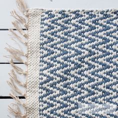 Blue rug, in a chevron geometric pattern, creating laid back Scandi style in your home. Jord Home natural fibre rug in indigo blue designed to add depth