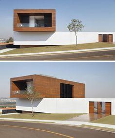 This modern home in Brazil has a Cumaru wood clad concrete box that extends out over the long white exterior wall.