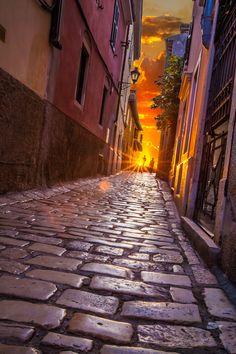 Ancient street Rovinj Croatia at sunset