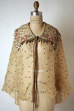 Cape  Elsa Schiaparelli  (Italian, 1890–1973)  Date: 1930s Culture: French Medium: silk, metal, plastic