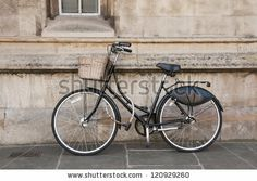 Vintage Bicycle Outside a College in Cambridge, UK by Martin Parratt, via Shutterstock