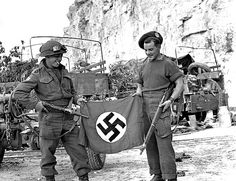 Canadian Boys from Ottawa Normandy (Misc.) - Privates L. Roy and R. Parker, Cameron Highlanders of Ottawa, with a German flag captured in a quarry south of Hautmesnil. Canadian Boys, Canadian Soldiers, Les Cents, World Empire, Germany Ww2, Fourth World, Remembrance Day, D Day, Juni