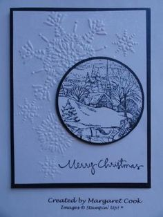 handmade Christmas card ... looks blues but probably white and navy ... luv the circle medallion with stamped winter scene ... background with large snowflakes corner embossing folder ... like it! ... Stampin' Up! by bethany