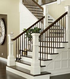 Traditional White and Dark Wood Staircases- like the wood paneling on the side of the stairs