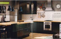 Kitchen wood & black with white tile.