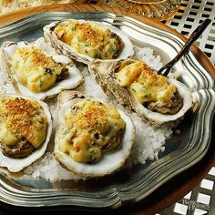 Oysters smothered in a white wine sauce chock-full of shrimp and mushrooms, then topped with Parmesan crumbs, makes this a rich treat. When buying fresh oysters, look for those with tightly closed shells and a fresh scent (not a strong fishy odor). Oyster Recipes, Cajun Recipes, Fish Recipes, Seafood Recipes, Appetizer Recipes, Great Recipes, Cooking Recipes, Favorite Recipes, Cooking Tips