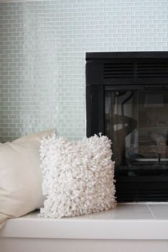 Glass tiles - Fireplace makeover for the master bedroom | Find Joy in the Journey
