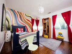 Design Around Their Passions - An Eclectic, Colorful Boy's Room on HGTV - one fun COLORFUL wall - like!