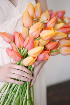 tulip bouquet, styling by Sarah Park Events, photo by Sweet Root Village http://ruffledblog.com/orange-crush-wedding-ideas #flowers #weddingbouquet #tulips