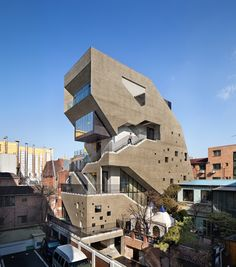 bang by min carves angular external stairway from concrete mixed-use building in…
