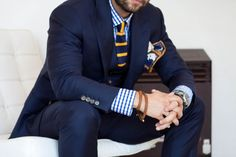 Navy suit, blue gingham shirt, navy tie with yellow stripes