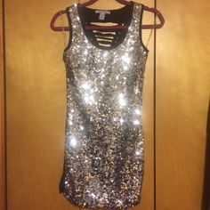 Dress Sequin and very sparkly mini, form fitting dress! See the reflection off of the light?! Super comfortable and moveable. Only worn once for NYE! Perfect for a night out! Poetry Dresses Mini