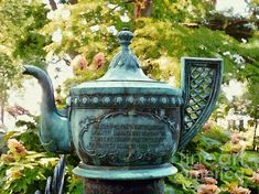 Edenton NC Teapot Garden Party  The 1905 Bronze Teapot now covered in a Verdigris patina perched on the edge of the Chowan County Courthouse Green.  A memorial to commemorate the 1774 protest location where Mrs. Elizabeth King and the Ladies of Edenton met to protest the tax that the British had placed on Tea.  A prettier little Southern town you would be hard pressed to find.  Art by Janine Riley #edentonnc #edeontonteapot  #teapot #edentonnorthcarolina #chowancounty #albemarlesound