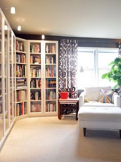 DIY BILLY Bookcases with Height Extensions and Glass Doors. #easy #DIY #corner #bookshelves #livingroom