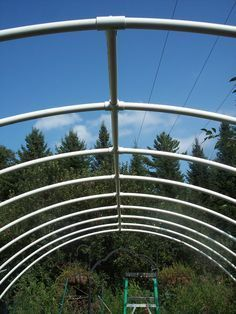 Hoop house - many uses. Early pen for new chicks greenhouse winter garden early spring garden rain shelter for animals/chooks . make it mobile for garden rotation etc. Dont use wood for base as it will rot. Make entire structure with PVC pipe Build A Greenhouse, Greenhouse Gardening, Container Gardening, Cheap Greenhouse, Greenhouse Ideas, Serre Pvc, Rain Shelter, Wooden Greenhouses, Parasol