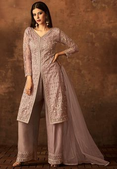 Dusty Mauve Embroidered Palazzo Suit features a net heavy kameez with satin raw silk inner, satin raw silk bottom and net dupatta. Embroidery work on this style is completed with thread, stone, and zari embellishments. Salwar Suits Pakistani, Pakistani Suits Online, Salwar Kameez, Punjabi Suits, Designer Suits Online, Designer Wear, Designer Dresses, Salwar Suits Simple, Salwar Suits Party Wear