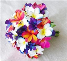 Natural Touch Fuchsia, Blue, Tropical Punch and Purple Orchids & Plumerias Bouquet