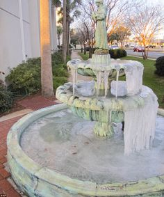 St. Simon's on the Sound Episcopal Church's fountains were frozen over Tuesday just after sunrise in Fort Walton Beach, Florida where locals...