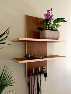 Modern floating Shelf/Entryway organizer. Finally a place to stash those Walking in and out of the door things.. Keep sunglasses scratch free, hide those keys... and keep the leash handy!  Sleek minimalist design keeps it modern and totally unique with 3 stainless hooks to hang keys, leashes, etc..  **All of my pieces are designed and built by me. Each and every one handcrafted with care**  I designed this with California Walnut ply and solid Maple trim. I am in LOVE with the idea of mix...