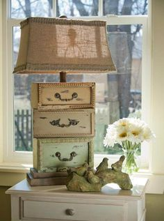 Use decor boxes you can find at Dollar General. Lamp made from drawers with a burlap shade