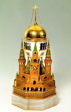 The Moscow Kremlin Egg (or The Uspenski Cathedral Egg), opalescent white and translucent guilloche green enamel, oil painting, music box playing Cherub Hymn, 1906. Presented by Nicholas II to Tsarina Alexandra Fyodorovna. The Kremlin Armoury Museum, Moscow