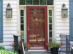 Storm door installation is an inexpensive way to reduce drafts, protect your door, and save energy. Learn how to install a storm door with this guide. Painted Storm Door, Painted Doors, Painted Metal, Exterior Front Doors, Patio Doors, Gray Exterior, Garage Doors, Entry Doors, Exterior Paint
