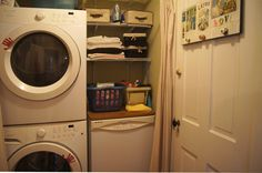 utility room with extra towels, a rack of cleaning supplies, iron and board, washer/dryer and even a dishwasher. look for our airbnb id: 7658872