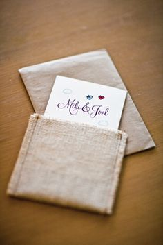 . burlap envelopes .  We could get plain invites and put the invite & RSVP card and map, etc in the burlap envelope