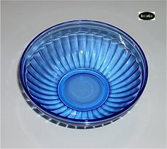 Pattern name: Aurora | Manufacturer: Hazel Atlas | Years Made: Late 1930s | Primary colour: Cobalt blue | Other colours: Crystal, Green, Pink | This pattern is a basic breakfast set consisting of a cup and saucer, two sizes of bowls, a 6.5-inch plate, a cream pitcher and a 10-ounce tumbler. | 1