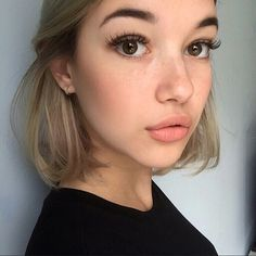 Brows, curled lashes, peachy-nude blush & lip-color. This look is GORGEOUS, especially the blush
