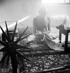 On this day in 1948 Gandhi was assassinated in New Delhi by a Hindu fanatic. Pictured here in 1946, the leader sits next to a spinning wheel, a device used to make yarn or thread; the image came to symbolize Indian self sufficiency — and thus independence from British rule.