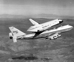 NASAs Space Shuttle Orbiter Enterprise is shown mated atop its 747 carrier jet during the first captive test flight of the Orbiter February 18, 1977 over the Mojave Desert of Southern California.