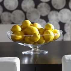 Footed glass bowl with like fruit, a great centerpiece.