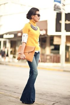Layering - Mustard turtleneck paired with cream blouse, denim flare leg jeans and large tan clutch
